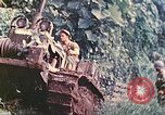 Image of US 5th Marines use winch to pull armored vehicle uphill Talasea New Britain Papua New Guinea, 1944, second 22 stock footage video 65675063814