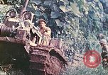 Image of US 5th Marines use winch to pull armored vehicle uphill Talasea New Britain Papua New Guinea, 1944, second 23 stock footage video 65675063814