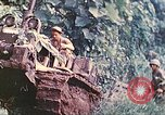 Image of US 5th Marines use winch to pull armored vehicle uphill Talasea New Britain Papua New Guinea, 1944, second 26 stock footage video 65675063814