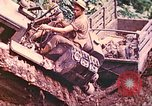 Image of US 5th Marines use winch to pull armored vehicle uphill Talasea New Britain Papua New Guinea, 1944, second 27 stock footage video 65675063814