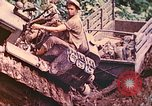 Image of US 5th Marines use winch to pull armored vehicle uphill Talasea New Britain Papua New Guinea, 1944, second 28 stock footage video 65675063814