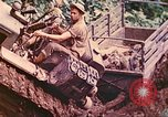 Image of US 5th Marines use winch to pull armored vehicle uphill Talasea New Britain Papua New Guinea, 1944, second 29 stock footage video 65675063814