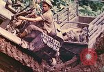 Image of US 5th Marines use winch to pull armored vehicle uphill Talasea New Britain Papua New Guinea, 1944, second 30 stock footage video 65675063814