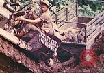 Image of US 5th Marines use winch to pull armored vehicle uphill Talasea New Britain Papua New Guinea, 1944, second 31 stock footage video 65675063814