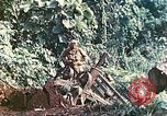 Image of US 5th Marines use winch to pull armored vehicle uphill Talasea New Britain Papua New Guinea, 1944, second 44 stock footage video 65675063814