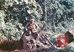 Image of US 5th Marines use winch to pull armored vehicle uphill Talasea New Britain Papua New Guinea, 1944, second 46 stock footage video 65675063814