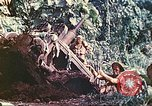 Image of US 5th Marines use winch to pull armored vehicle uphill Talasea New Britain Papua New Guinea, 1944, second 55 stock footage video 65675063814