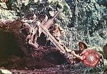 Image of US 5th Marines use winch to pull armored vehicle uphill Talasea New Britain Papua New Guinea, 1944, second 56 stock footage video 65675063814