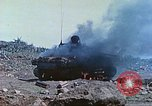 Image of Japanese artillery fires at U.S. tanks Iwo Jima, 1945, second 18 stock footage video 65675063846