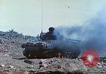Image of Japanese artillery fires at U.S. tanks Iwo Jima, 1945, second 21 stock footage video 65675063846