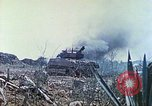 Image of Japanese artillery fires at U.S. tanks Iwo Jima, 1945, second 27 stock footage video 65675063846
