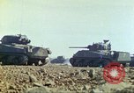Image of 3rd Marine Division Sherman tanks fire at Japanese positions Iwo Jima, 1945, second 21 stock footage video 65675063852