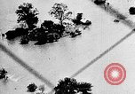 Image of tornado and flood United States USA, 1930, second 37 stock footage video 65675068850