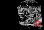 Image of Steam locomotive pushing a train backwards Taiwan, 1940, second 8 stock footage video 65675069924