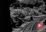 Image of Steam locomotive pushing a train backwards Taiwan, 1940, second 9 stock footage video 65675069924