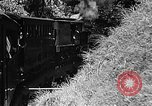 Image of Steam locomotive pushing a train backwards Taiwan, 1940, second 17 stock footage video 65675069924