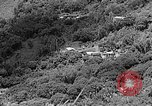 Image of Steam locomotive pushing a train backwards Taiwan, 1940, second 18 stock footage video 65675069924