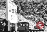 Image of Steam locomotive pushing a train backwards Taiwan, 1940, second 46 stock footage video 65675069924