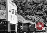 Image of Steam locomotive pushing a train backwards Taiwan, 1940, second 48 stock footage video 65675069924