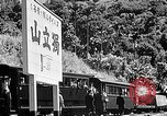 Image of Steam locomotive pushing a train backwards Taiwan, 1940, second 50 stock footage video 65675069924