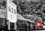 Image of Steam locomotive pushing a train backwards Taiwan, 1940, second 51 stock footage video 65675069924