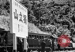 Image of Steam locomotive pushing a train backwards Taiwan, 1940, second 52 stock footage video 65675069924