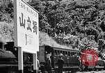 Image of Steam locomotive pushing a train backwards Taiwan, 1940, second 54 stock footage video 65675069924