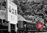 Image of Steam locomotive pushing a train backwards Taiwan, 1940, second 55 stock footage video 65675069924