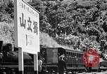 Image of Steam locomotive pushing a train backwards Taiwan, 1940, second 56 stock footage video 65675069924