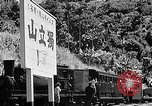 Image of Steam locomotive pushing a train backwards Taiwan, 1940, second 57 stock footage video 65675069924