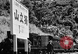 Image of Steam locomotive pushing a train backwards Taiwan, 1940, second 58 stock footage video 65675069924