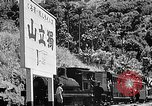 Image of Steam locomotive pushing a train backwards Taiwan, 1940, second 60 stock footage video 65675069924