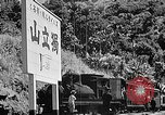 Image of Steam locomotive pushing a train backwards Taiwan, 1940, second 61 stock footage video 65675069924