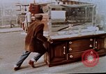 Image of looting of Wolfe Bros. furniture store during riots Washington DC USA, 1968, second 10 stock footage video 65675070916
