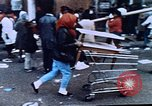 Image of looting of Wolfe Bros. furniture store during riots Washington DC USA, 1968, second 23 stock footage video 65675070916