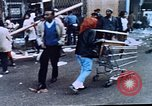 Image of looting of Wolfe Bros. furniture store during riots Washington DC USA, 1968, second 24 stock footage video 65675070916