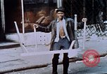 Image of looting of Wolfe Bros. furniture store during riots Washington DC USA, 1968, second 34 stock footage video 65675070916