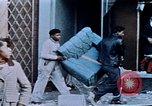 Image of looting of Wolfe Bros. furniture store during riots Washington DC USA, 1968, second 36 stock footage video 65675070916