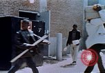 Image of looting of Wolfe Bros. furniture store during riots Washington DC USA, 1968, second 47 stock footage video 65675070916