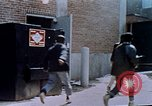 Image of looting of Wolfe Bros. furniture store during riots Washington DC USA, 1968, second 48 stock footage video 65675070916