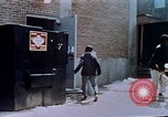 Image of looting of Wolfe Bros. furniture store during riots Washington DC USA, 1968, second 49 stock footage video 65675070916