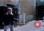 Image of looting of Wolfe Bros. furniture store during riots Washington DC USA, 1968, second 52 stock footage video 65675070916