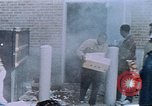 Image of looting of Wolfe Bros. furniture store during riots Washington DC USA, 1968, second 53 stock footage video 65675070916