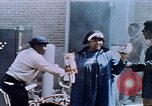 Image of looting of Wolfe Bros. furniture store during riots Washington DC USA, 1968, second 55 stock footage video 65675070916