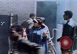 Image of looting of Wolfe Bros. furniture store during riots Washington DC USA, 1968, second 57 stock footage video 65675070916