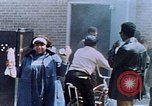 Image of looting of Wolfe Bros. furniture store during riots Washington DC USA, 1968, second 58 stock footage video 65675070916