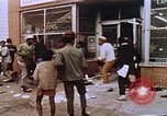 Image of looters at pawn shop Washington DC USA, 1968, second 17 stock footage video 65675070917