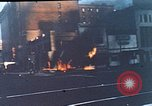 Image of burning building in riot after death of Martin Luther King Jr Washington DC USA, 1968, second 1 stock footage video 65675070919
