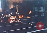 Image of burning building in riot after death of Martin Luther King Jr Washington DC USA, 1968, second 4 stock footage video 65675070919