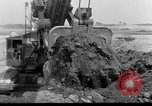 Image of dam under construction United States USA, 1956, second 30 stock footage video 65675070983
